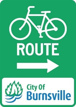 Green Bike Lane Sign with Arrow pointing right