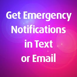 Red and blue lights. Text: Get emergency notifications in text or email