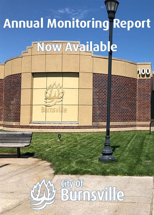 Front facade of Burnsville City Hall. Text: Annual Monitoring Report Now Available
