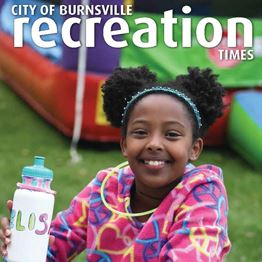 2019 Recreation Times cover featuring children laying in autumn leaves