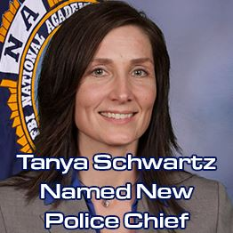 Schwartz stands in front of a National Academy flag. Text: Tanya Schwartz Named New Police Chief