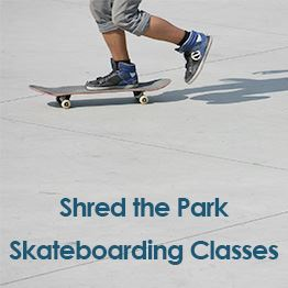 Image from the knees down of a person on a skateboard. Text: Shred the Park Skateboarding Classes