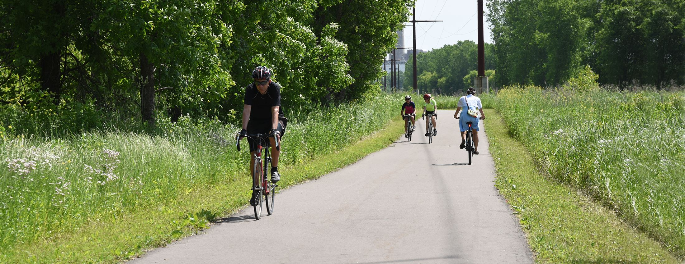 People bike on the Minnesota River Greenway trail