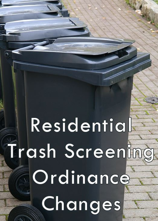 Line of black trash cans. Text: Residential trash screening ordinance changes